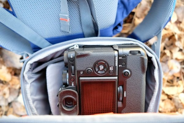 I tried to fit my Fuji X-T2 with a vertical booster grip on it and found it was a tight fit