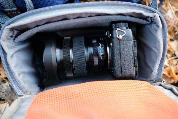 Fuji X-T2 with 10-24mm lens and lens hood on stored sideways